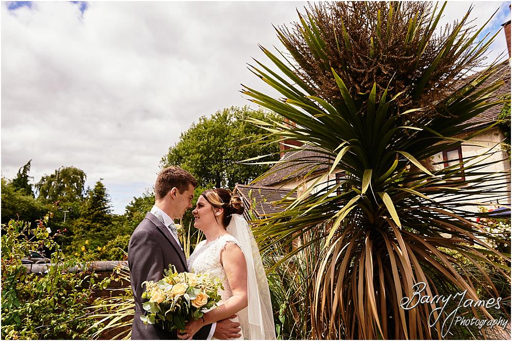 Creative contemporary photographs of the bride and groom in the beautiful front gardens at Oak Farm Cannock by Stafford Wedding Photographer Barry James