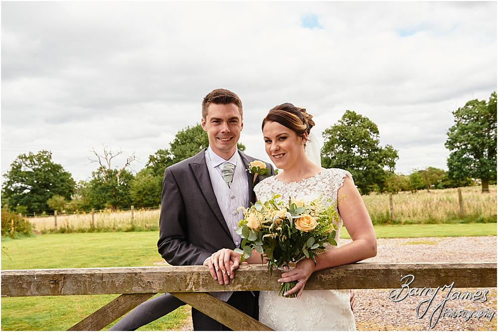 Elegant portraits of the bride and groom in the rear gardens at Oak Farm Cannock by Stafford Wedding Photographer Barry James