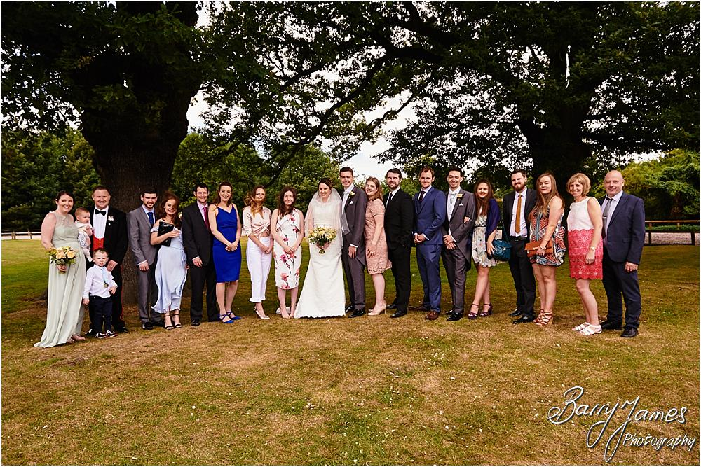 Relaxed family photographs during the wedding reception at Oak Farm Cannock by Stafford Wedding Photographer Barry James