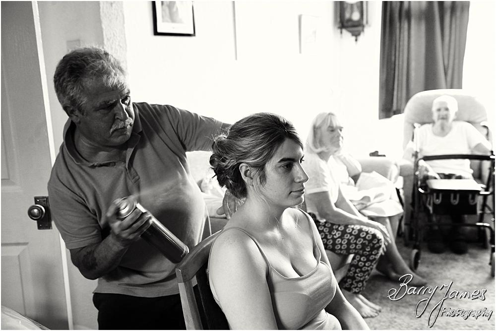 Creative candid photographs of the bridal preparations before the wedding at St Michaels Church Pelsall by Walsall Wedding Photographer Barry James