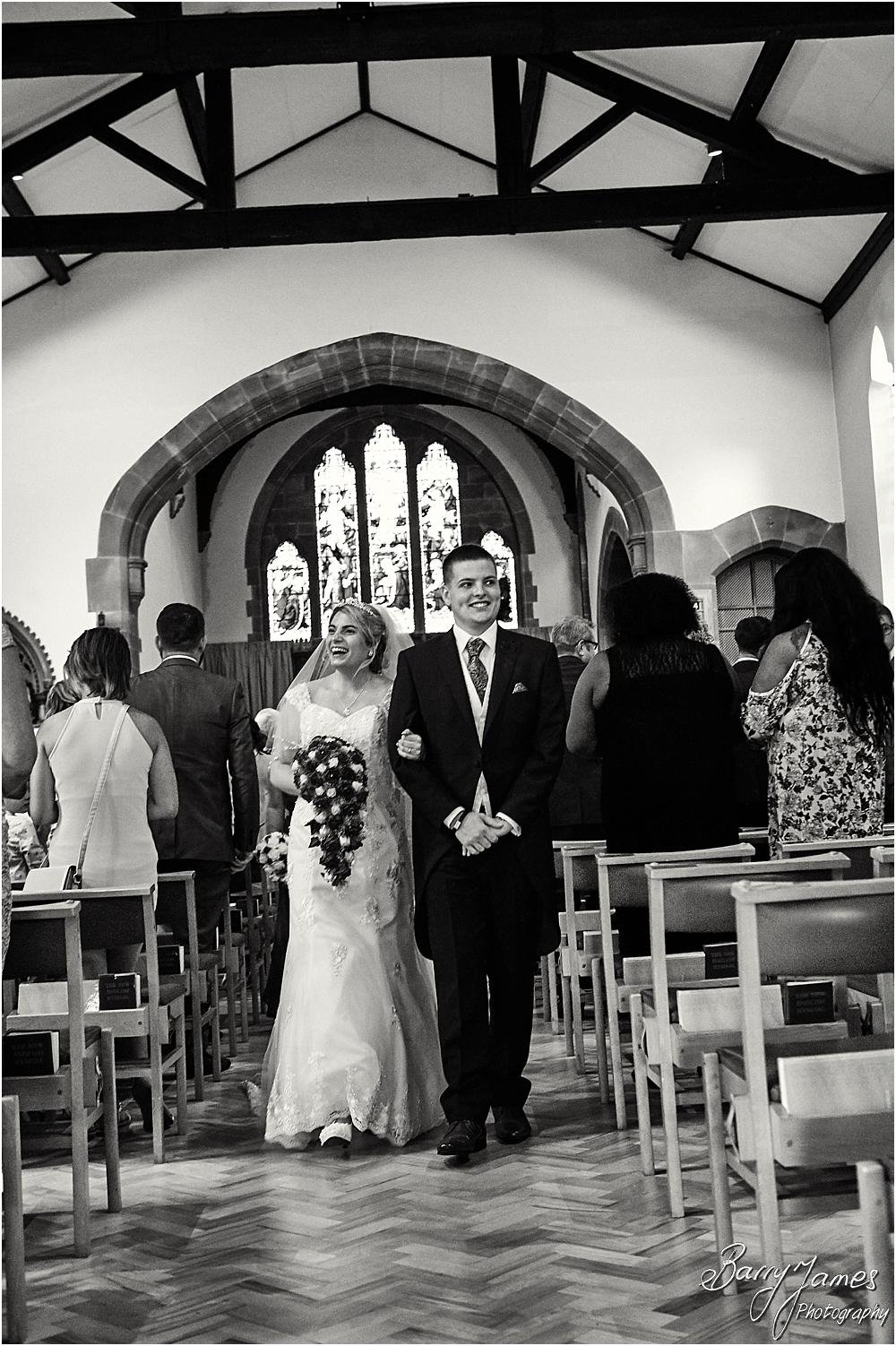 Unobtrusive photographs of the beautiful wedding ceremony at St Michaels Church Pelsall by Walsall Wedding Photographer Barry James