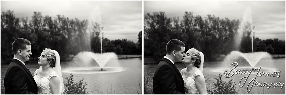 Beautiful photographs of the bride and groom in the stunning lakeside grounds at Calderfields Walsall by Walsall Wedding Photographer Barry James