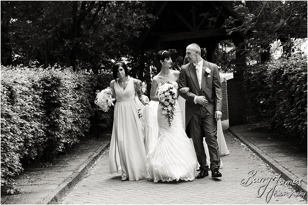 Candid photographs of the final journey to her groom on the arm of her father at All Saints Church in Bloxwich by Walsall Wedding Photographer Barry James