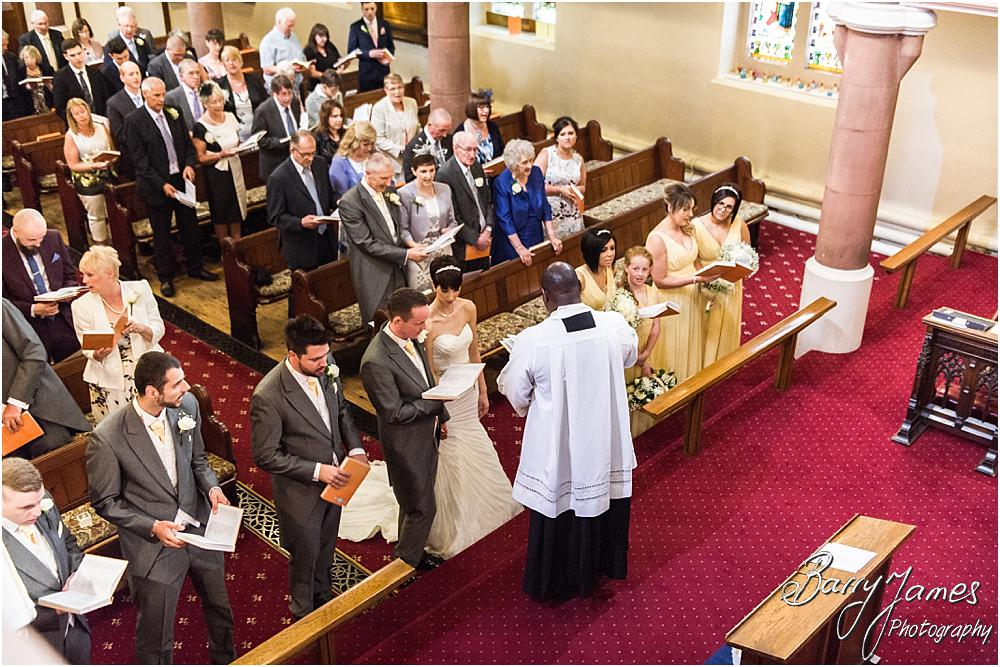 Unobtrusive photographs of the wedding ceremony at All Saints Church in Bloxwich by Walsall Wedding Photographer Barry James