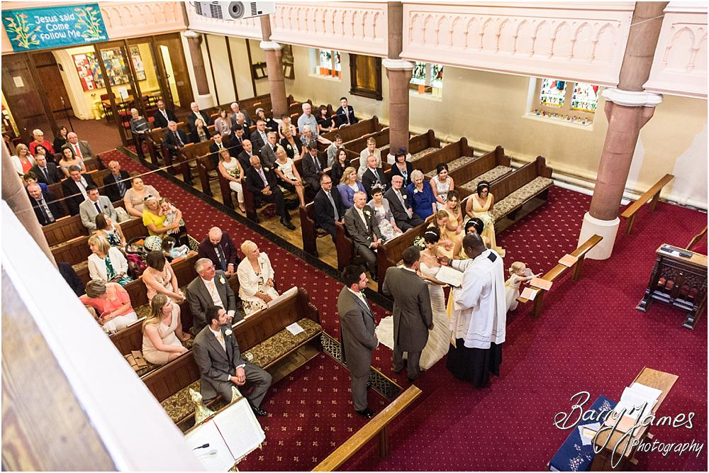 Candid and contemporary photographs of the ring and vow exchange during the wedding at All Saints Church in Bloxwich by Walsall Wedding Photographer Barry James
