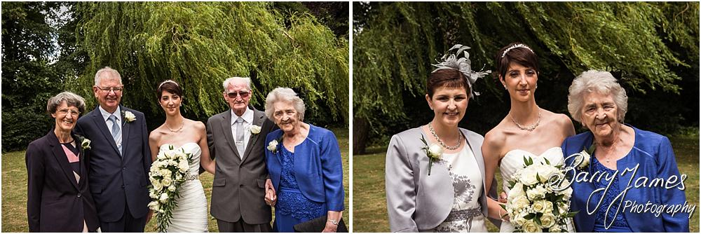 Relaxed family groups in the church gardens at All Saints Church in Bloxwich by Walsall Wedding Photographer Barry James