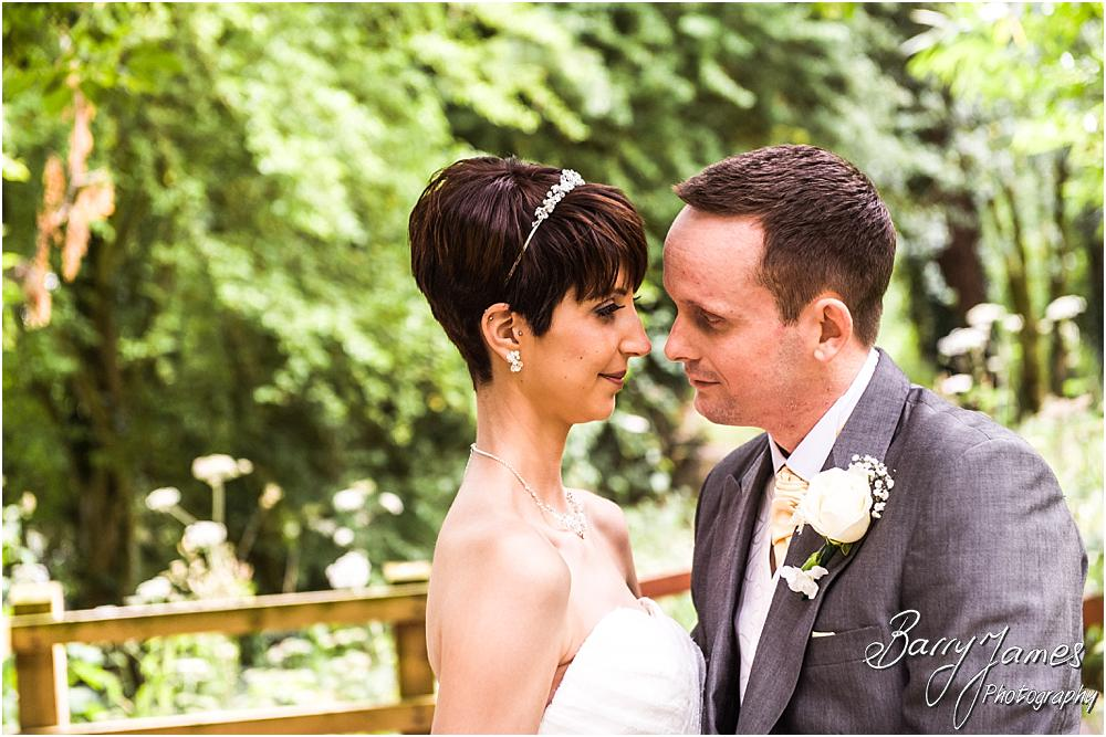 Creative portraits of the Bride and Groom around the beautiful gardens at Rodbaston Hall in Penkridge by Walsall Wedding Photographer Barry James