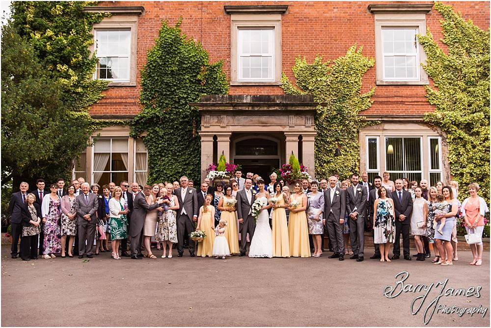 Group photograph at Rodbaston Hall in Penkridge by Walsall Wedding Photographer Barry James