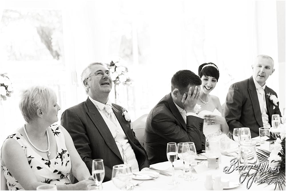 Photos that show the reaction to the humorous best mans speech at Rodbaston Hall in Penkridge by Walsall Wedding Photographer Barry James