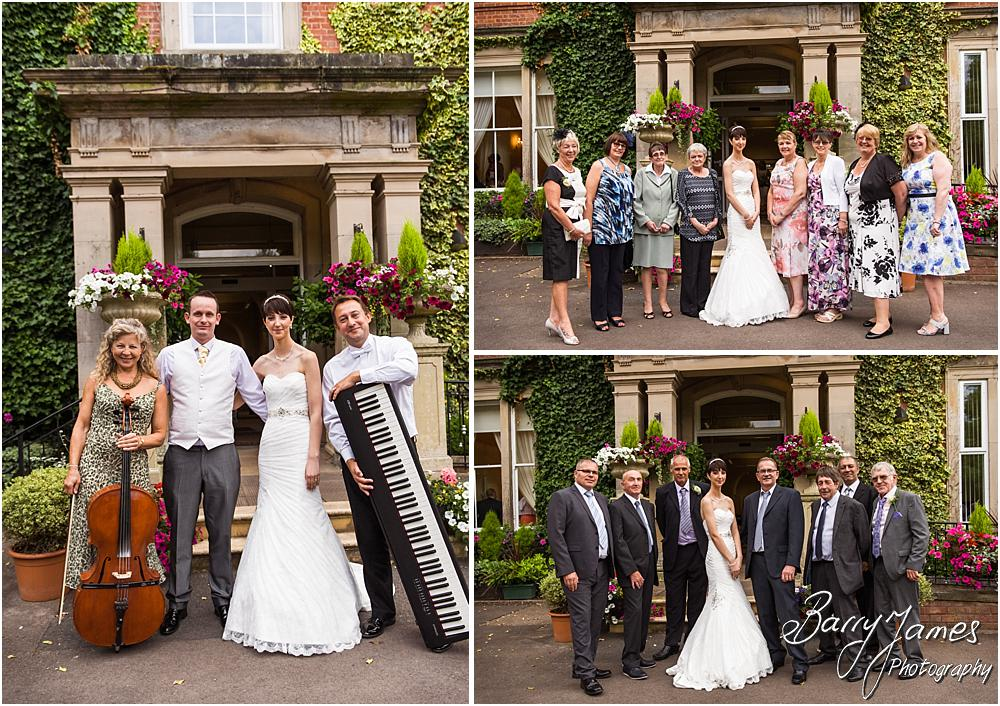 Relaxed family groups on the steps at Rodbaston Hall in Penkridge by Walsall Wedding Photographer Barry James