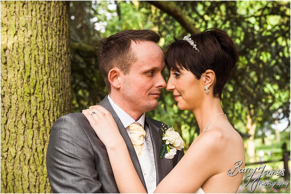 Creative evening portraits of the Bride and Groom at Rodbaston Hall in Penkridge by Walsall Wedding Photographer Barry James