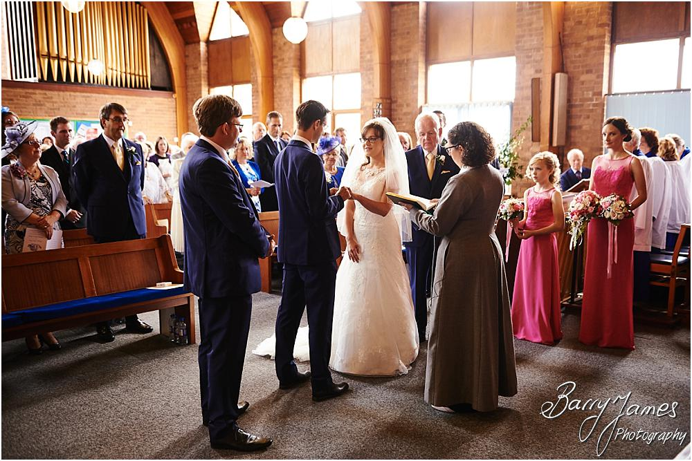 Unobtrusive storytelling photographs of the beautiful wedding ceremony at Brownhills Methodist Church in Walsall by Walsall Wedding Photographer Barry James