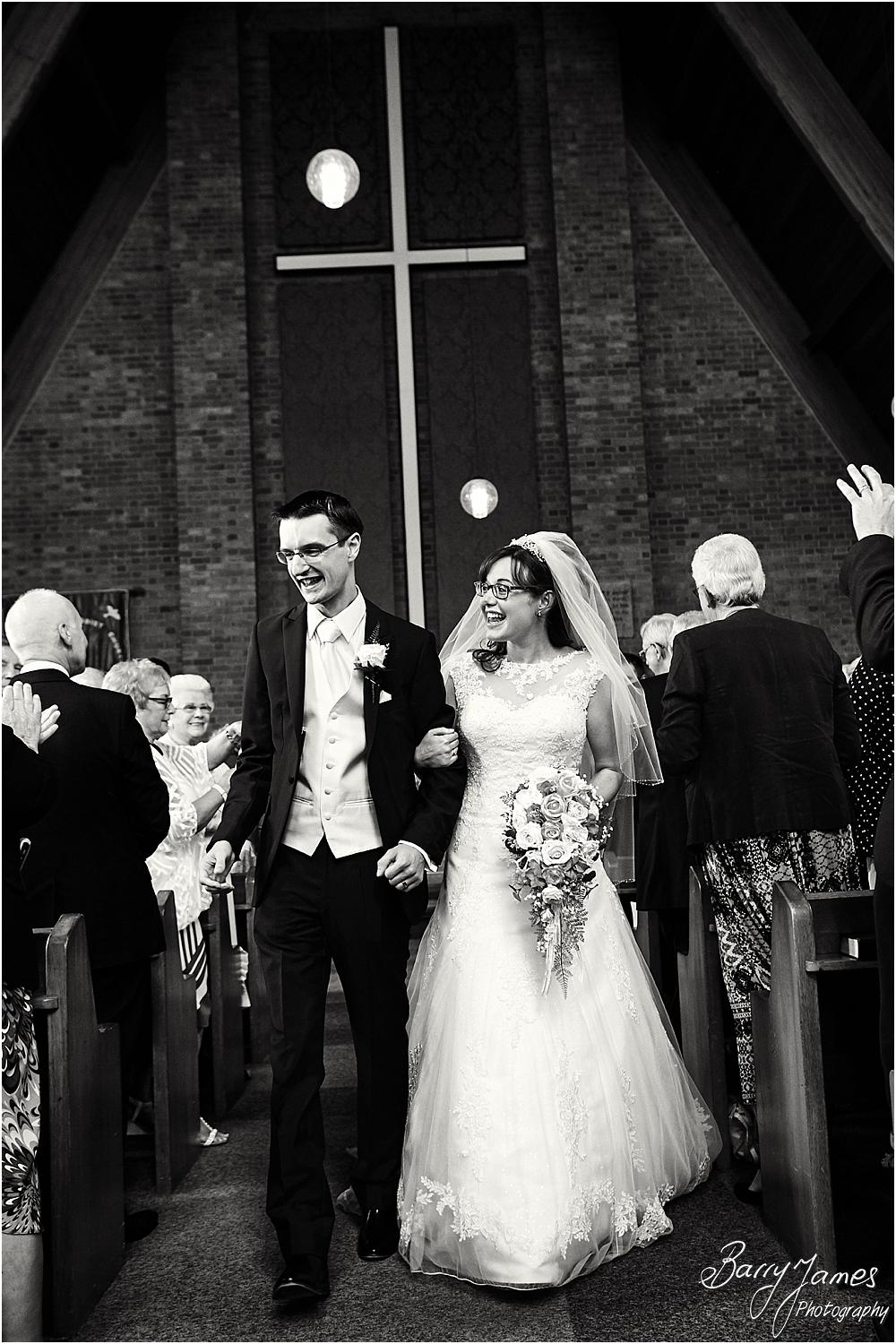 Candid photographs of the beautiful recessional for the newly married Mr & Mrs Booth at Brownhills Methodist Church in Walsall by Walsall Wedding Photographer Barry James