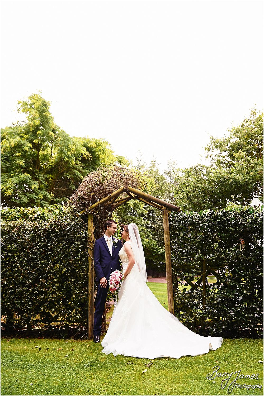 Elegant relaxed portraits of the bride and groom around the grounds of The Fairlawns in Walsall by Walsall Wedding Photographer Barry James