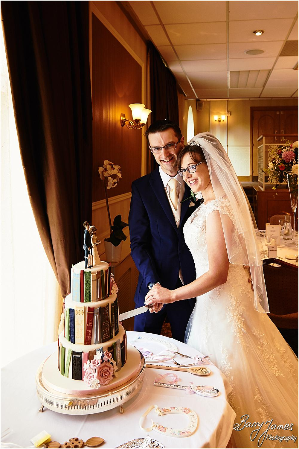 Cake cutting fun at The Fairlawns in Walsall by Walsall Wedding Photographer Barry James
