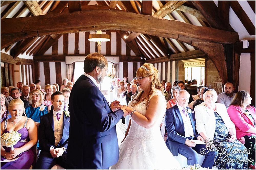 Unobtrusive photographs of the wedding ceremony that tell the story of the beautiful day in a relaxed candid style at Acton Trussell by Stafford Wedding Photographer Barry James