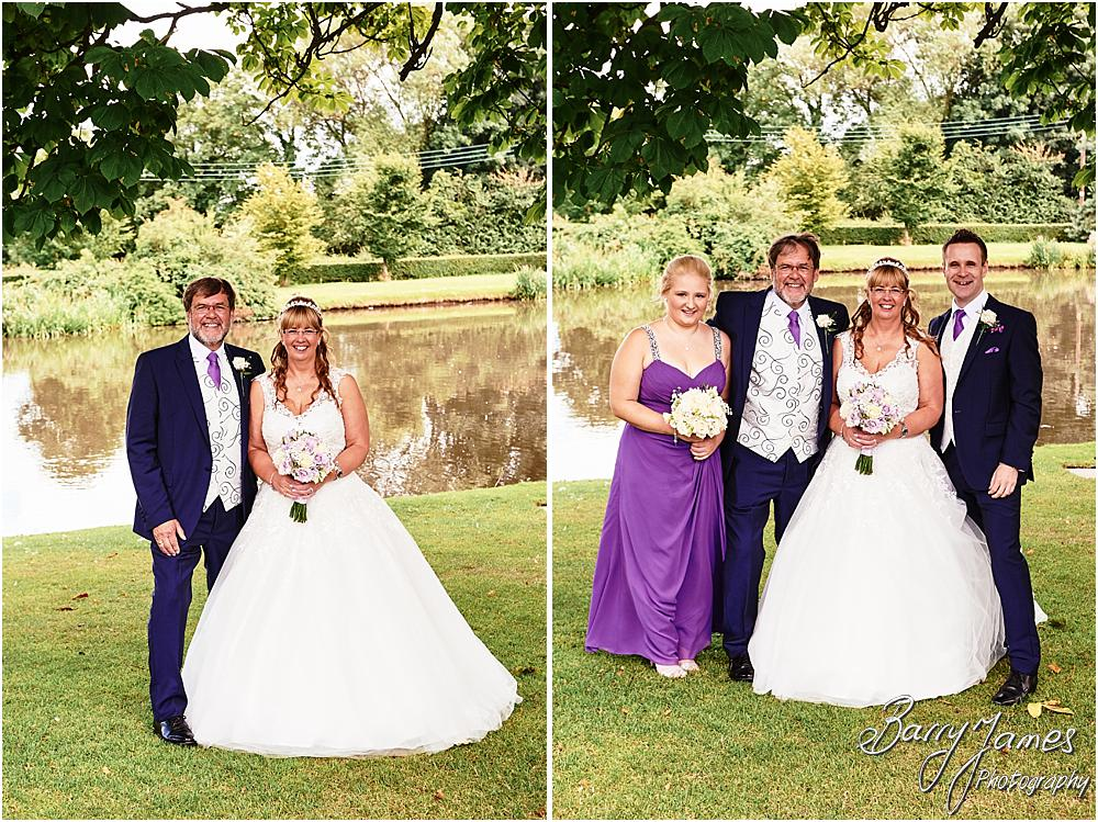 Relaxed family group photographs utilising the stunning lakeside setting at Acton Trussell by Stafford Wedding Photographer Barry James