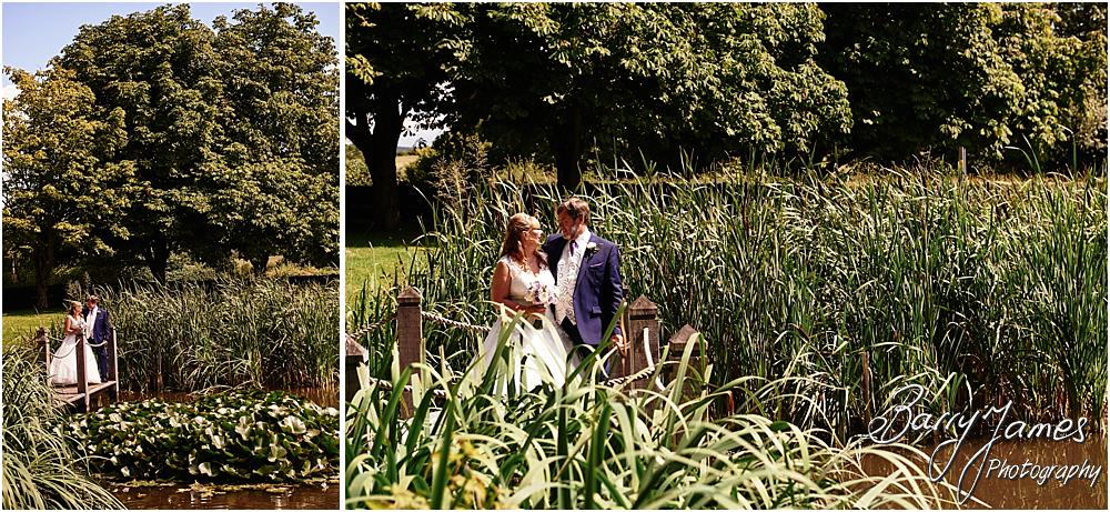 Stunning contemporary portraits of the Bride and Groom at the lakeside setting at Acton Trussell by Stafford Wedding Photographer Barry James
