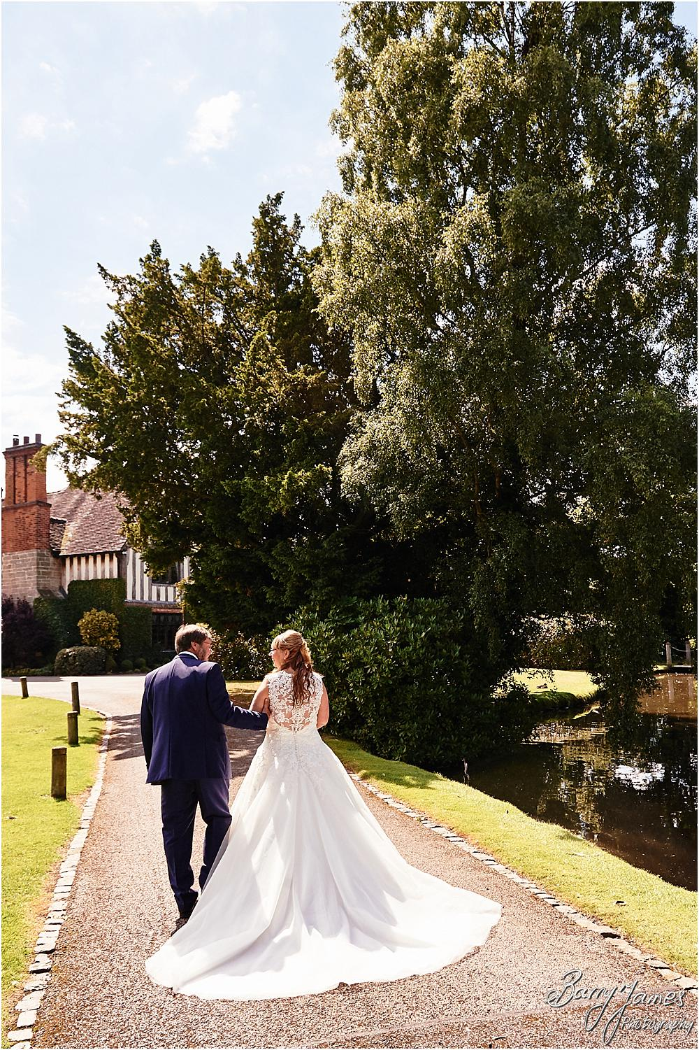 Creative natural portraits of the Bride and Groom with the perfect characterful setting and grounds at Acton Trussell by Stafford Wedding Photographer Barry James
