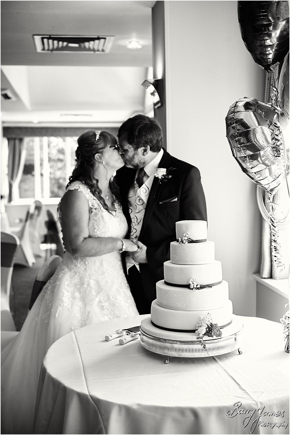 Cake cutting fun at Acton Trussell by Stafford Wedding Photographer Barry James