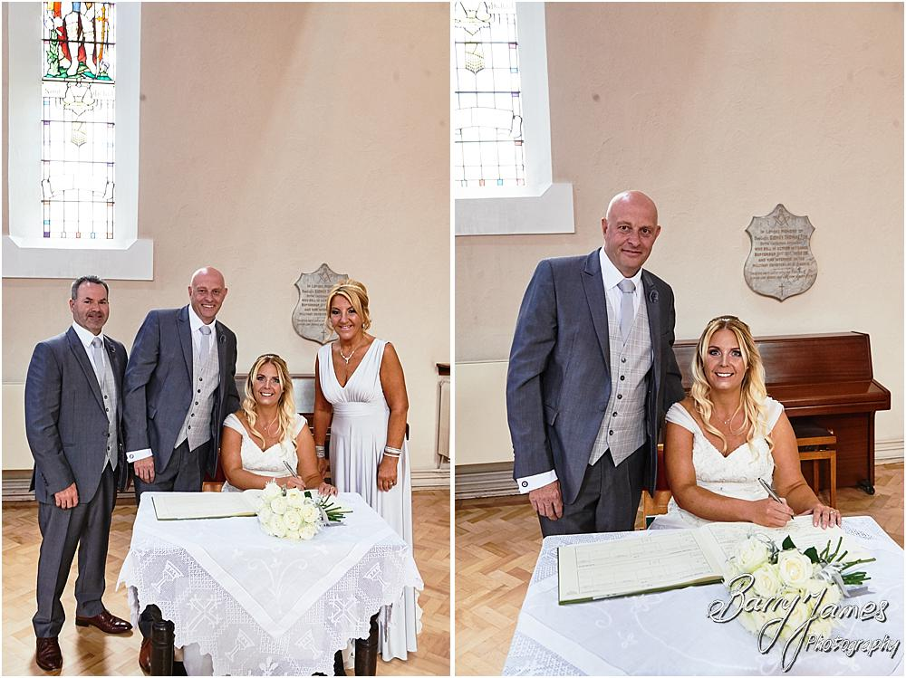 Creative unobtrusive photographs of the wedding ceremony at St Michaels Church in Pelsall by Walsall Wedding Photographer Barry James