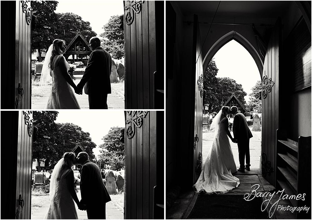Creative contemporary portraits of the Bride and Groom at the fabulous arched doorway at St Michaels Church in Pelsall by Walsall Wedding Photographer Barry James