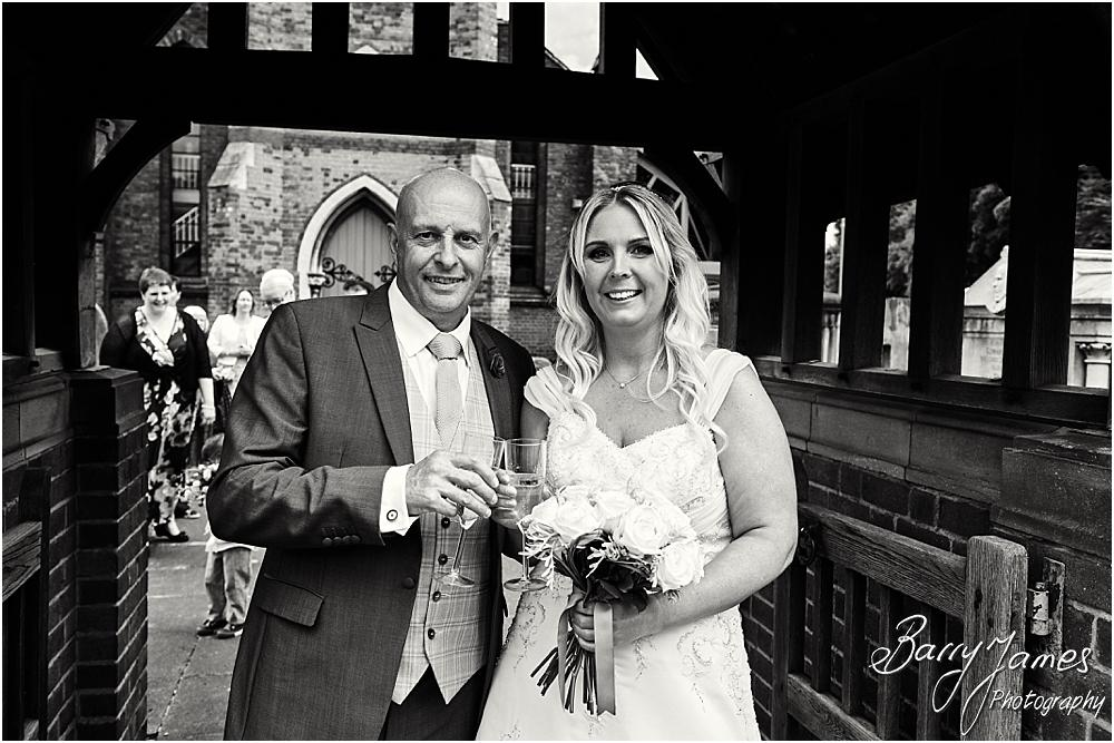 Confetti fun in the grounds at St Michaels Church in Pelsall by Walsall Wedding Photographer Barry James