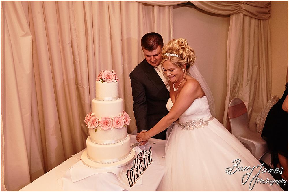 Cake cutting fun at Calderfields in Walsall by Calderfields Wedding Photographer Barry James