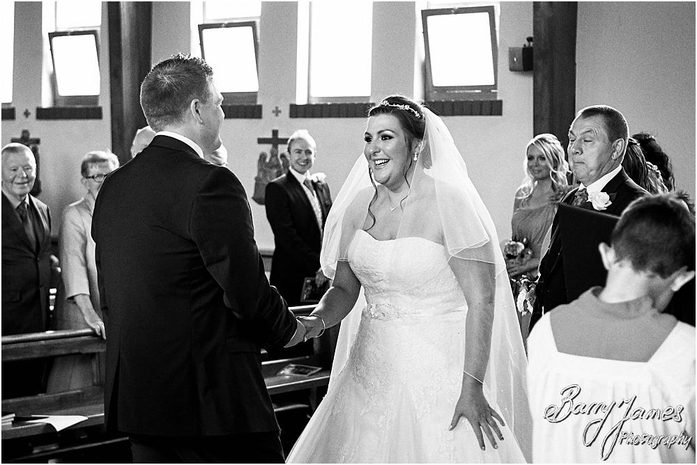 Unobtrusive storytelling photographs of the wedding ceremony at St Annes at Streetly by Wedding Photographer Barry James