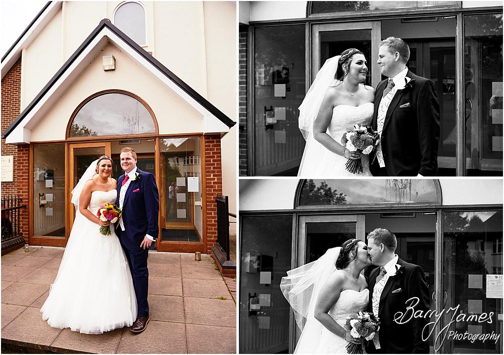 Family photographs on the church door at St Annes at Streetly by Wedding Photographer Barry James