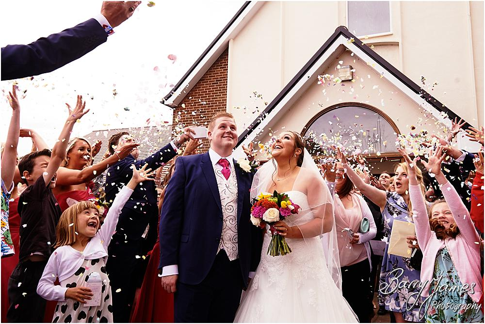 Confetti fun at St Annes at Streetly by Wedding Photographer Barry James