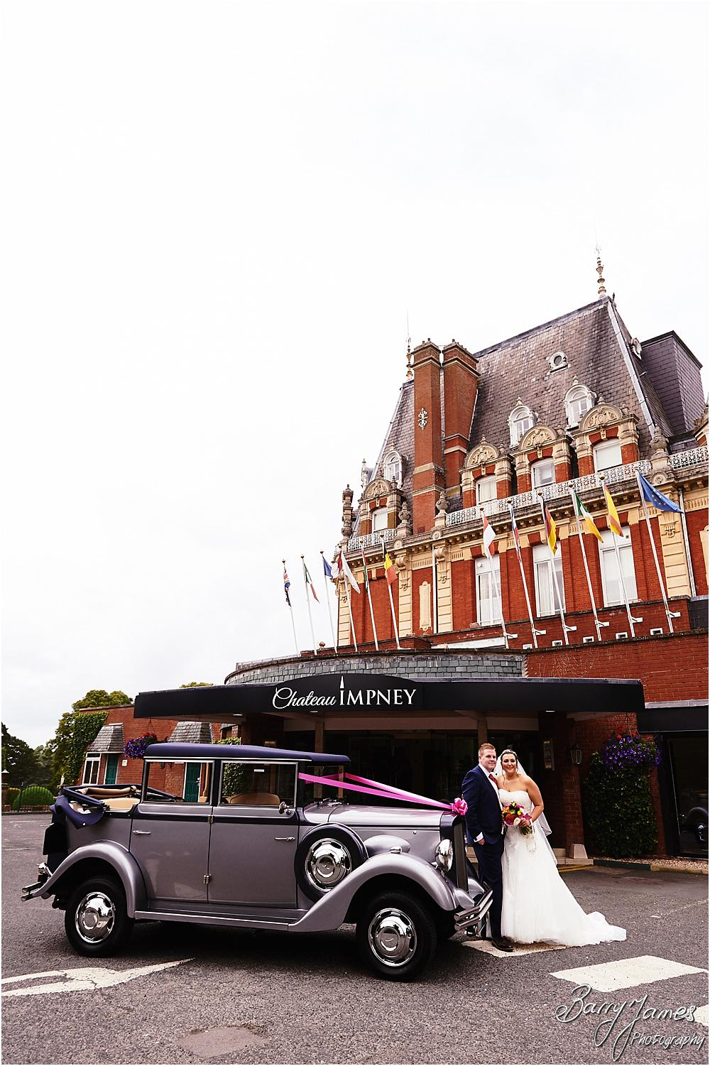 Arriving in style at Chateau Impney at Droitwich by Wedding Photographer Barry James