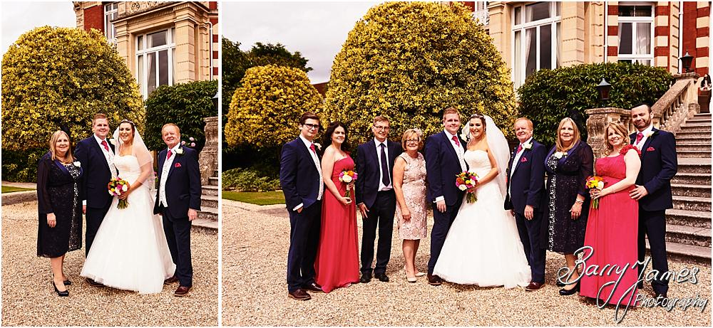 Relaxed family photographs during the wedding reception at Chateau Impney at Droitwich by Wedding Photographer Barry James