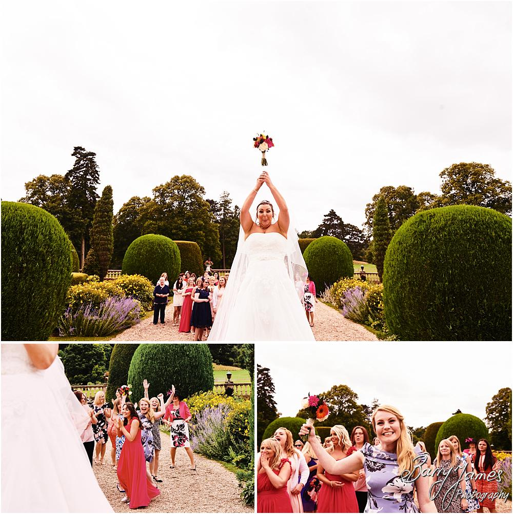 Bouquet toss fun at Chateau Impney at Droitwich by Wedding Photographer Barry James