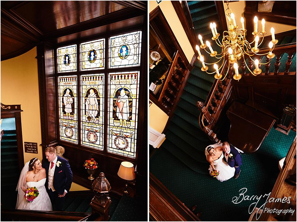 Creative photographs of the bride and groom utilising the beautiful staircase at Chateau Impney at Droitwich by Wedding Photographer Barry James