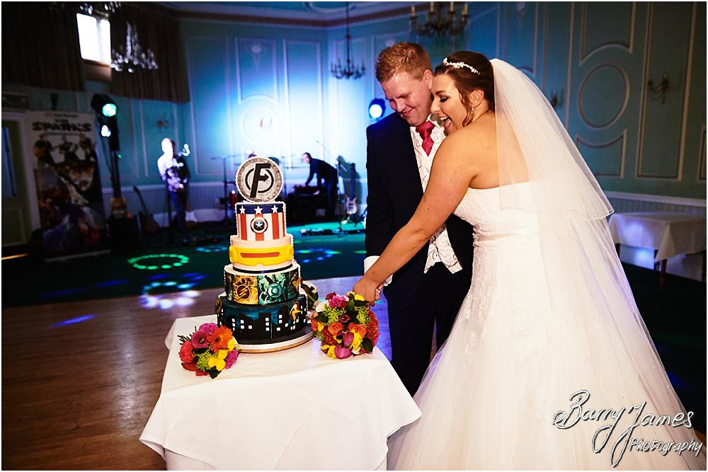 Cake cutting fun at Chateau Impney at Droitwich by Wedding Photographer Barry James