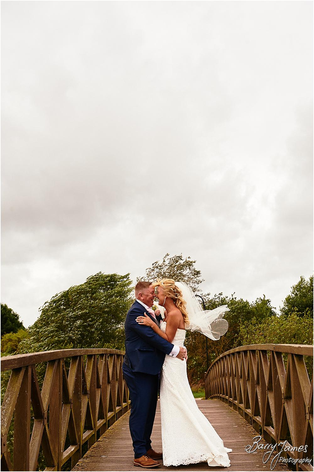 Utilising the stunning setting at The Crows Nest at Barton Marina for creative wedding portraits with Wedding Photographer Barry James