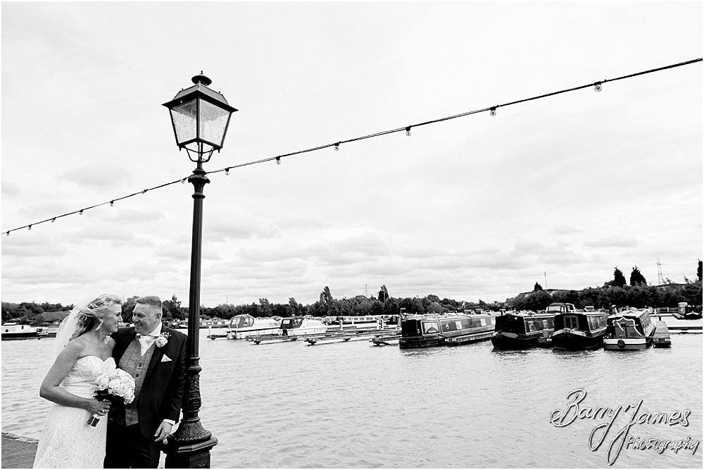 Utilising the stunning waterfront setting at The Crows Nest at Barton Marina for creative bride and groom portraits with Wedding Photographer Barry James