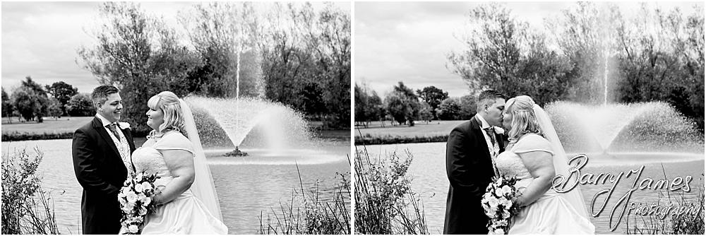 Elegant and relaxed portraits of the bride and groom around the lakeside gardens at Calderfields in Walsall by Walsall Wedding Photographer Barry James