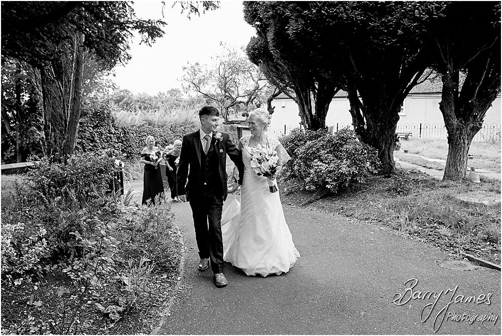 Capturing relaxed and creative photographs of the beautiful bride and bridesmaids at St Johns Church in Hammerwich by Burntwood Wedding Photographer Barry James