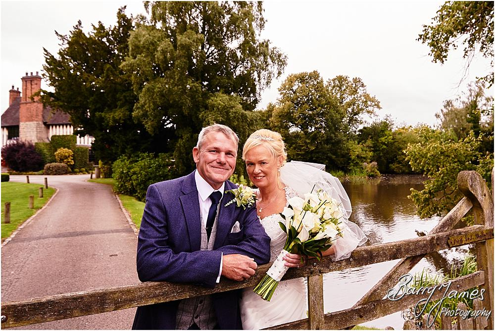 Beautiful natural portraits of the bride and groom at The Moat House in Acton Trussell by Hammerwich Wedding Photographer Barry James
