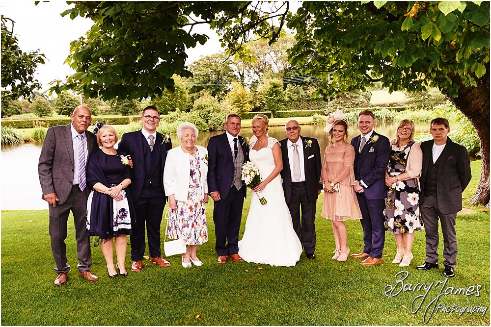 Natural family portraits on the lakeside at The Moat House in Acton Trussell by Hammerwich Wedding Photographer Barry James