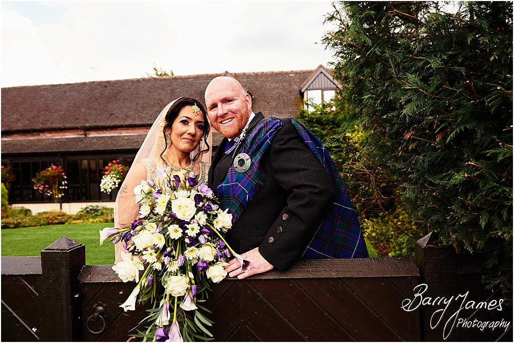 Creative portraits of the bride and groom in the stunning front gardens at Oak Farm Hotel in Cannock by Cannock Wedding Photographer Barry James