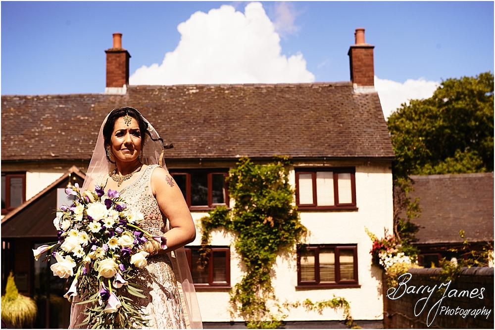 Creative photographs of the brides arrival for the beautiful wedding at Oak Farm Hotel in Cannock by Cannock Wedding Photographer Barry James