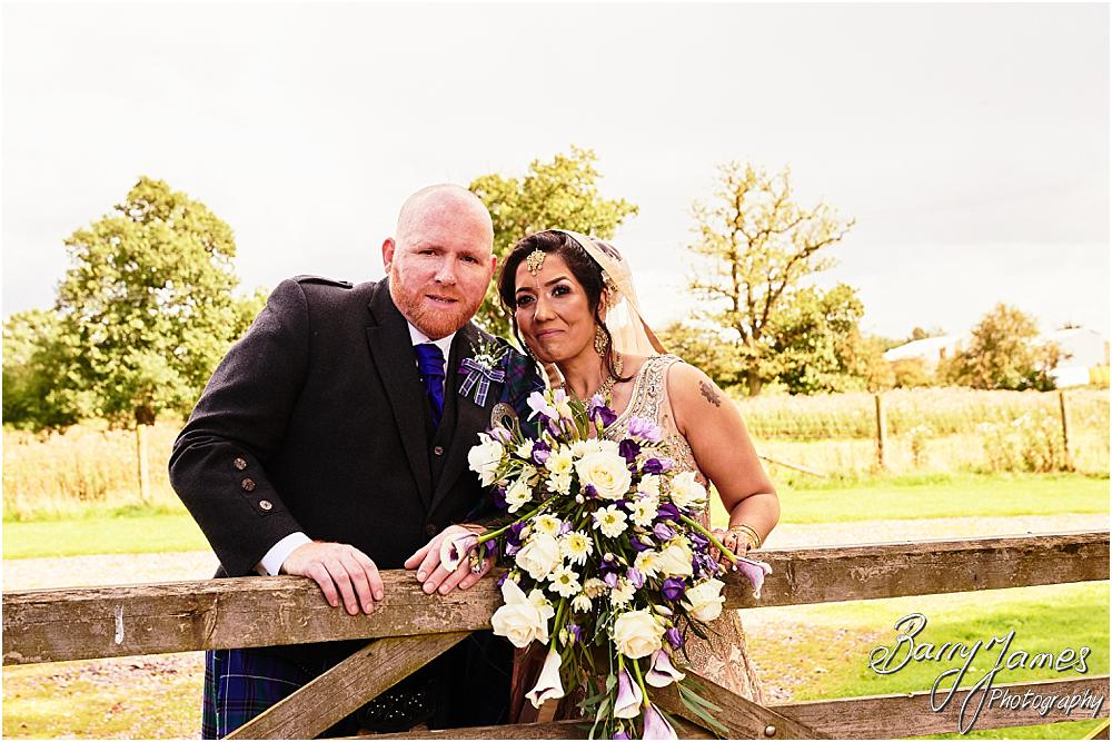 Beautiful portraits of the Bride and Groom in the countryside rear gardens of Oak Farm Hotel in Cannock by Cannock Wedding Photographer Barry James