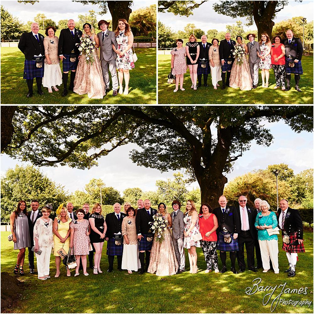 Relaxed natural family photographs during the drinks reception at Oak Farm Hotel in Cannock by Cannock Wedding Photographer Barry James