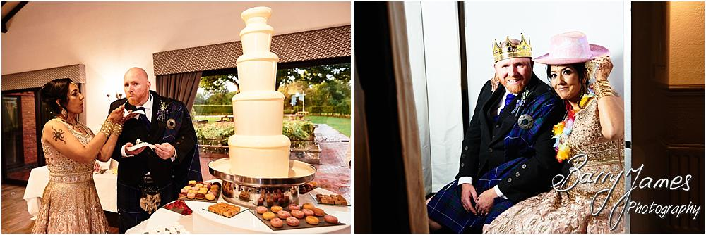 Cake cutting fun for the bride and groom at Oak Farm Hotel in Cannock by Cannock Wedding Photographer Barry James