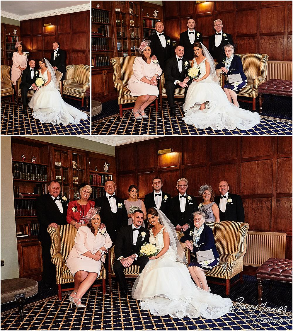 Relaxed family photographs during the wedding reception at The Moat House in Acton Trussell by Stafford Wedding Photographers Barry James