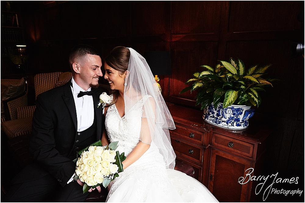 Beautiful portraits of our bride and groom in the library at The Moat House in Acton Trussell by Stafford Wedding Photographers Barry James