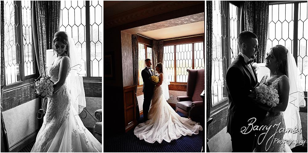 Creative portraits on the landing and staircase of our bride and groom at The Moat House in Acton Trussell by Stafford Wedding Photographers Barry James